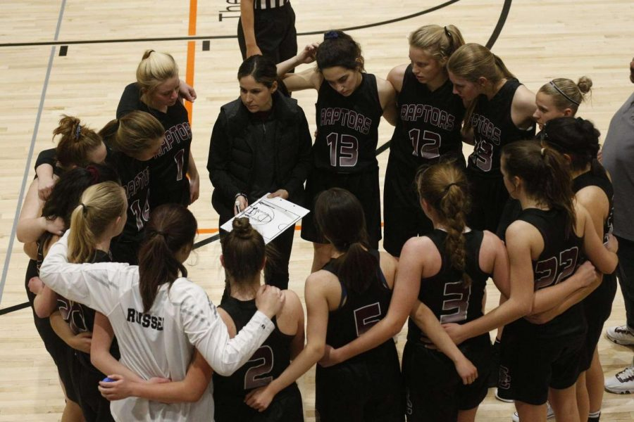 """Photo courtesy of Mackenzie Larson. The Silver Creek Girls Basketball team prepares for success, with their fearless leader, Coach Ashlee Runyon, in the middle.  When asked what she wants the team to be known as, she said, """"Hard working, Industrious, we outwork other teams even if we don't outskill other teams."""""""