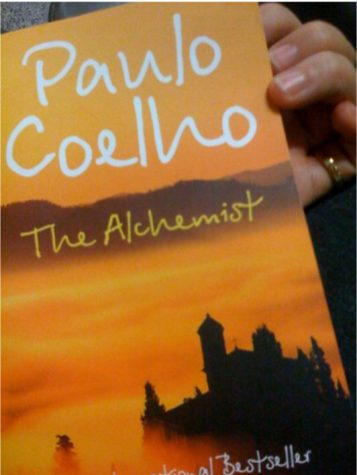"""The Alchemist by Paulo Coelho"" by SoniaT 360. is licensed with CC BY 2.0. To view a copy of this license, visit https://creativecommons.org/licenses/by/2.0/"