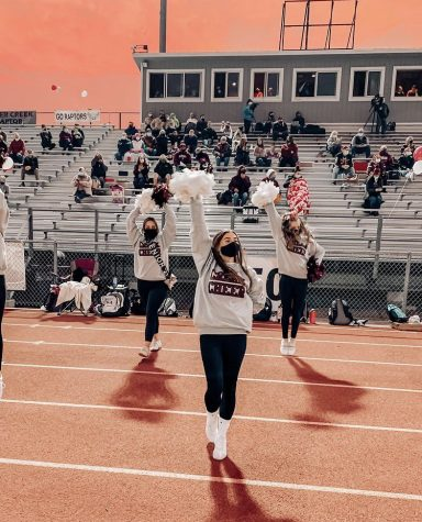 Silver Creek athletes cheer at a recent football game. In this photo Willow Martinez (senior), Bridget Hauger (junior), and Emma Reiner (freshmen) are cheering on their Raptor football players to victory. This football season was the very last and very first for some Silver Creek cheerleaders.